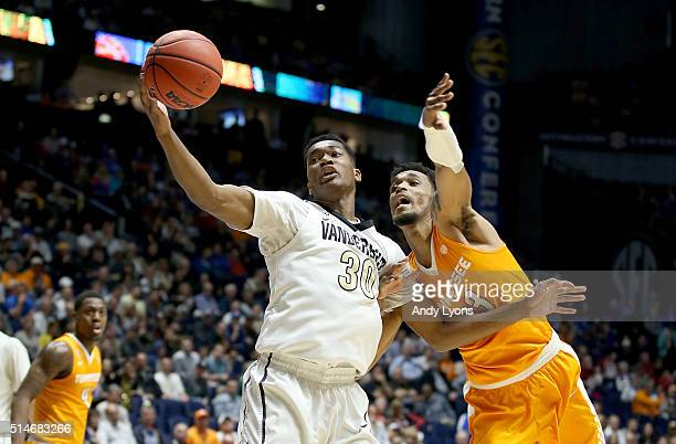 Damian Jones of the Vanderbilt Commodores reaches for the ball against the Tennessee Volunteers during the second round of the SEC Basketball...