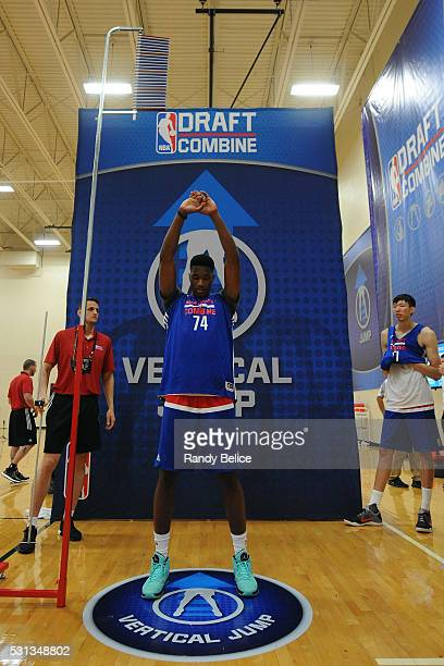 Damian Jones prepares to perform a Vertical Jump test while Zhou Qi awaits his turn during 2016 NBA Draft Combine on May 12 2016 at the Quest...