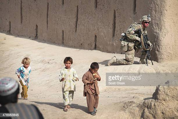 Damian Keller from Charleston South Carolina with the US Army's 4th squadron 2d Cavalry Regiment keeps watch during a joint patrol through a village...