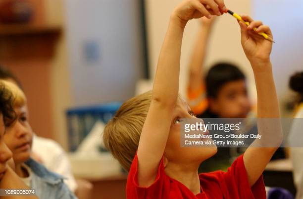 Damian King, a third grader at Alicia Sanchez Elementary School in Lafayette figits with his colored pencils while raising his hands during a math...