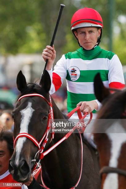 Damian Lane celebrates after riding Lys Gracieux to win race 9 the Ladbrokes Cox Plate during Cox Plate Day at Mooney Valley Racecourse on October...