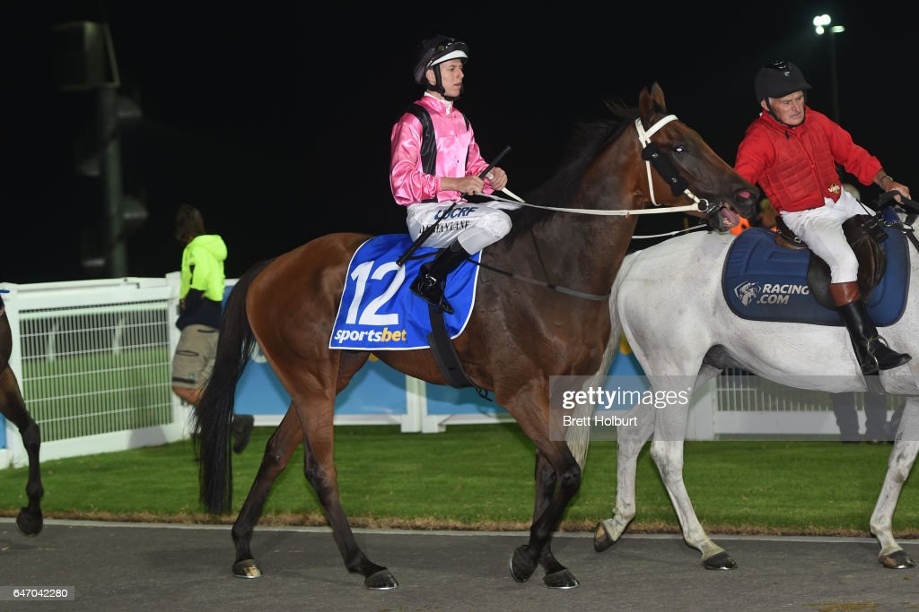 Damian Lane returns to the mounting yard on I Boogi (NZ) after winning Sportsbet Racing Form Grand Hcp Mile Mar 18 Win & You're In BM70 at Racing.com Park Racecourse on March 02, 2017 in Pakenham, Australia.