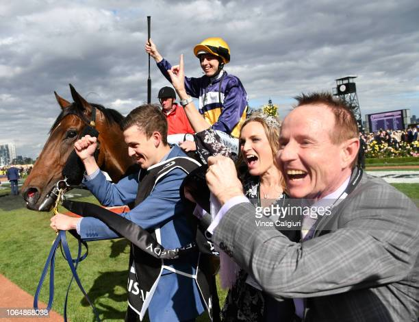 Damian Lane riding Aristia with connections after winning in Race 8, Kennedy Oaks during Oaks Day at Flemington Racecourse on November 08, 2018 in...