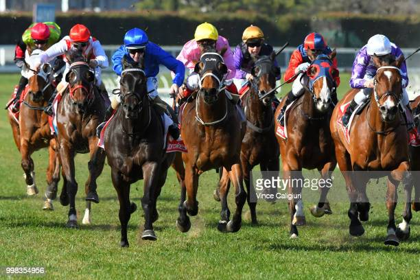 Damian Lane riding Demolition defeats Ben Melham riding The Avenger in Race 4 during Melbourne Racing at Caulfield Racecourse on July 14 2018 in...