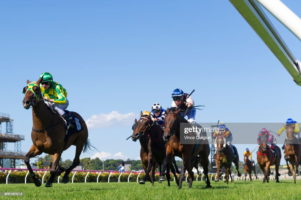 Damian Lane riding Parthesia (L) defeats Linda Meech riding Etah James in Race 7, Bagot Handicap during Melbourne Racing at Flemington Racecourse on January 1, 2018 in Melbourne, Australia.