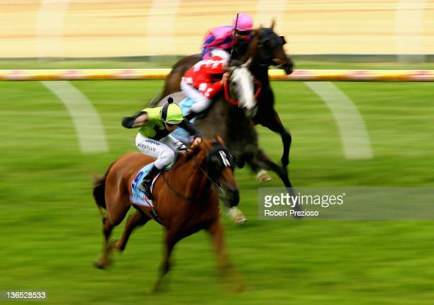 Damian Lane riding Royal Mail leads the field to win race Eight Mal Seccull Handicap during the Privileges Raceday at Caulfield Racecourse on January...