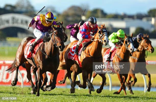 Damian Lane riding Written Era wins race 8 the Ladbrokes Cash In Handicap during Grand National Hurdle Day at Sandown Lakeside on August 6 2017 in...