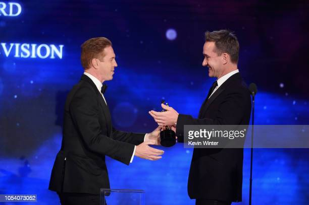 Damian Lewis accepts the Britannia Award for Excellence in Television from Matthew Macfadyen onstage at the 2018 British Academy Britannia Awards...