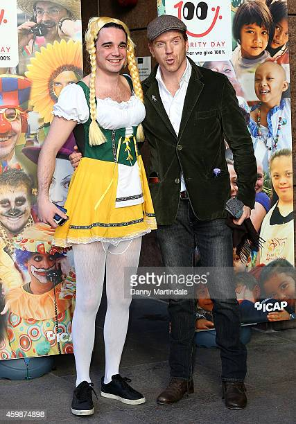 Damian Lewis and a man in fancy dress attend the Annual ICAP Charity Day at ICAP on December 3 2014 in London England
