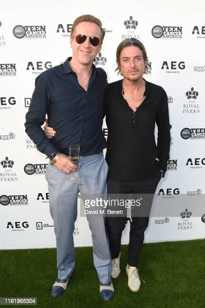 Damian Lewis and Darren Strowger attend the Teen Cancer America Suite at Bob Dylan and Neil Young in Hyde Park on July 12, 2019 in London, England.