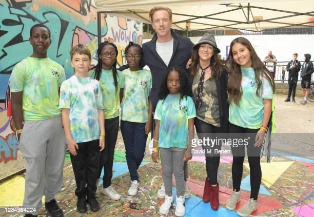 Damian Lewis and Debbi Clark pose with cast members Joshua Bamgbose, Riley De-Gragg, Breanna Caldeira, Rihanna Caldeira, Kalise Gatamba and Sienna...