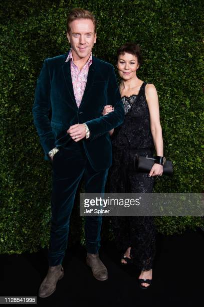 Damian Lewis and Helen McCrory attend the Charles Finch Chanel preBAFTA's dinner at Loulou's on February 09 2019 in London England