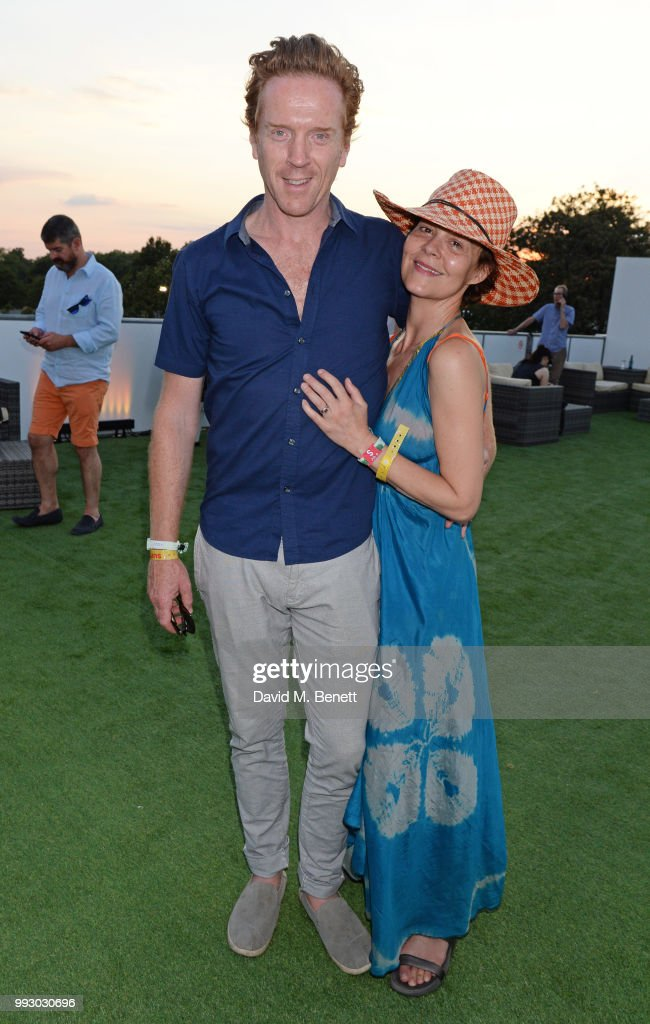 Damian Lewis (L) and Helen McCrory attend the London launch of intothewhite, Darren Strowger's ambitious new tech platform raising money for Teenage Cancer Trust through the auction of contemporary art, curated by Jake Chapman, backstage at British Summer Time Hyde Park on July 6, 2018 in London, England.
