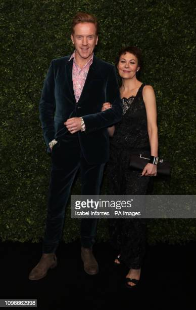Damian Lewis and his wife Helen McCrory arrive for the Charles Finch x Chanel preBafta dinner in Mayfair London