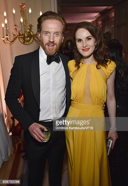 Damian Lewis and Michelle Dockery attend the Bloomberg Vanity Fair cocktail reception following the 2015 WHCA Dinner at the residence of the French...