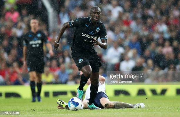 Damian Lewis and Yaya Toure fight for the ball during the Soccer Aid for UNICEF 2018 match between England and The Rest of the World at Old Trafford...