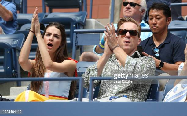Damian Lewis Bee Shaffer attend the match of Roger Federer of Switzerland in his player's box during day 4 of the 2018 tennis US Open on Arthur Ashe...