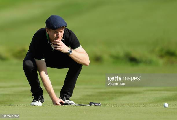 Damian Lewis lines up a put on the 4th during the BMW PGA Championship ProAM at Wentworth on May 24 2017 in Virginia Water England