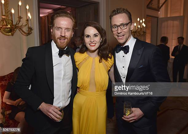 Damian Lewis Michelle Dockery and Tom Hiddleston attend the Bloomberg Vanity Fair cocktail reception following the 2015 WHCA Dinner at the residence...