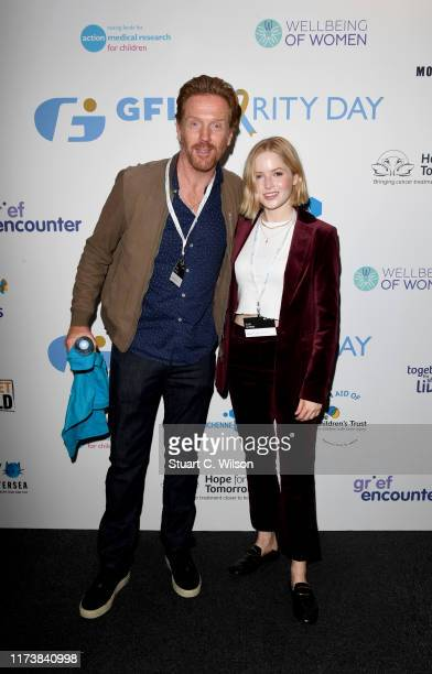 Damian Lewis OBE representing Cure EB and Ellie Bamber representing the Wellbeing of Women attend the GFI Charity Day to commemorate the 658...