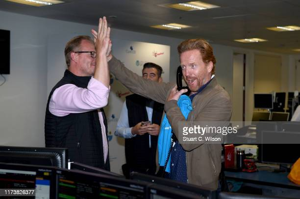Damian Lewis OBE representing Cure EB makes a trade at the GFI Charity Day to commemorate the 658 employees who perished on September 11 2001 in the...