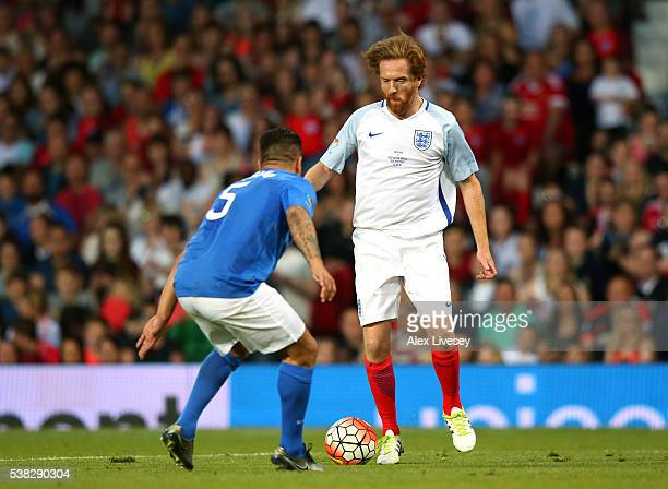 Damian Lewis of England takes on Fabio Cannavaro of Rest of the World during the Soccer Aid 2016 match in aid of UNICEF at Old Trafford on June 5,...