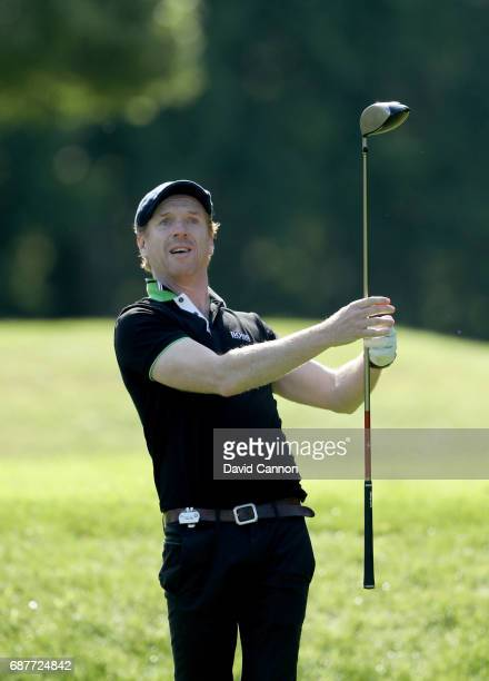 Damian Lewis of England the film television and stage actor plays a shot during the proam for the 2017 BMW PGA Championship on the West Course at...