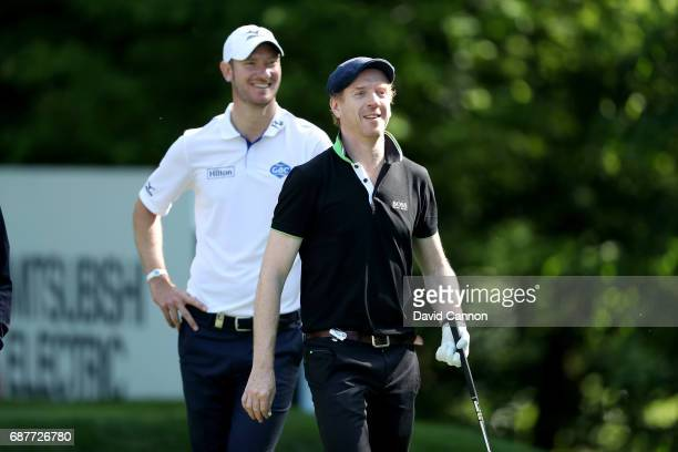 Damian Lewis of England the film television and stage actor watched by Chris Wood his professional partner during the proam for the 2017 BMW PGA...