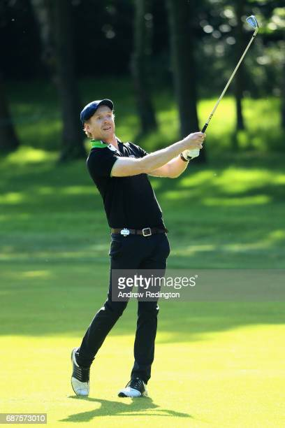 Damian Lewis plays his second shot on the 3rd during the BMW PGA Championship ProAM at Wentworth on May 24 2017 in Virginia Water England