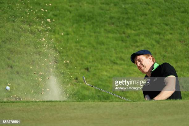 Damian Lewis plays out of a bunker on the 3rd during the BMW PGA Championship ProAM at Wentworth on May 24 2017 in Virginia Water England