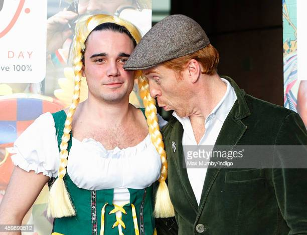 Damian Lewis poses with an ICAP employee wearing fancy dress as he attends the annual ICAP Charity Day at ICAP on December 3, 2014 in London, England.