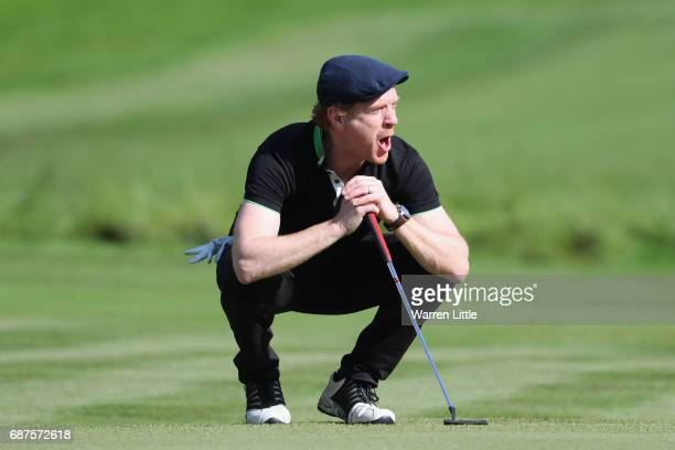 Damian Lewis reacts on the 4th after Chris Wood Chips in during the BMW PGA Championship ProAM at Wentworth on May 24 2017 in Virginia Water England