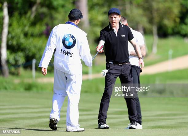 Damian Lewis reacts on the 4th during the BMW PGA Championship ProAM at Wentworth on May 24 2017 in Virginia Water England