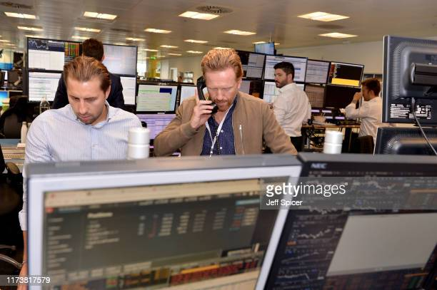 Damian Lewis representing Cure EB makes a trade at the GFI Charity Day to commemorate the 658 employees who perished on September 11 2001 in the...