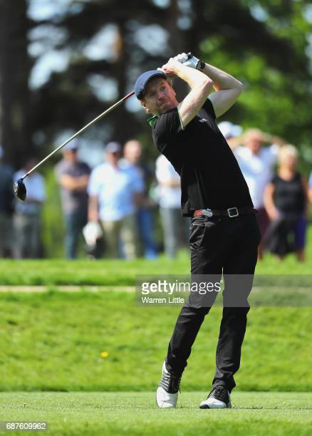 Damian Lewis tees off on the 11th during the BMW PGA Championship ProAM at Wentworth on May 24 2017 in Virginia Water England