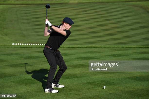 Damian Lewis tees off on the 1st hole during the BMW PGA Championship ProAm at Wentworth on May 24 2017 in Virginia Water England