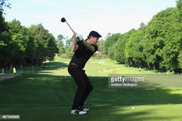 Damian Lewis tees off on the 3rd during the BMW PGA Championship ProAM at Wentworth on May 24 2017 in Virginia Water England
