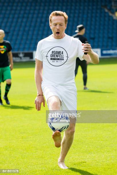 Damian Lewis warms up during the #GAME4GRENFELL at Loftus Road on September 2, 2017 in London, England. The charity football match has been set up to...