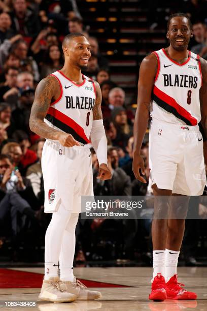 Damian Lillard and AlFarouq Aminu of the Portland Trail Blazers smiles against the Cleveland Cavaliers on January 16 2019 at the Moda Center in...