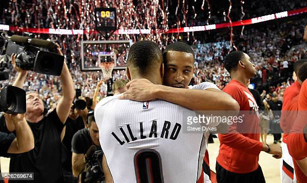 Damian Lillard and CJ McCollum of the Portland Trail Blazers celebrate after winning Game Six of the Western Conference Quarterfinals against the Los...