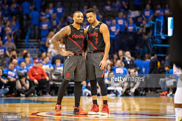 Damian Lillard and CJ McCollum of the Portland Trail Blazers huddle at mid court during a game against the Oklahoma City Thunder during Round One...
