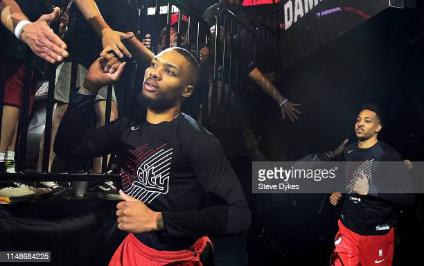 Damian Lillard and CJ McCollum of the Portland Trail Blazers run out of the tunnel before Game Six of the Western Conference Semifinals against the...
