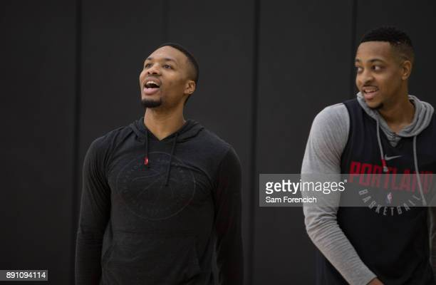 Damian Lillard and CJ McCollum of the Portland Trail Blazers smile and look on during an all access practice on December 7 2017 at the Trail Blazer...