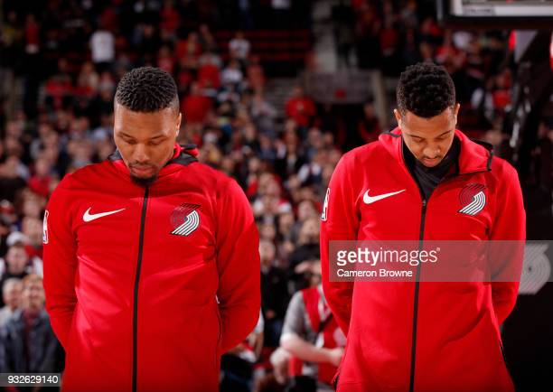 Damian Lillard and CJ McCollum of the Portland Trail Blazers stand for the National Anthem before the game against the Cleveland Cavaliers on March...