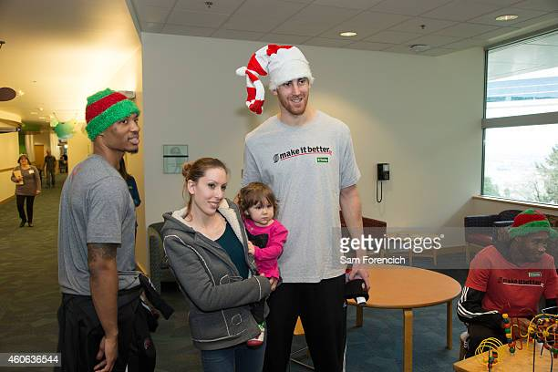 Damian Lillard and Victor Claver of the Portland Trail Blazers celebrate the holidays with patients and families December16 2014 during a team visit...