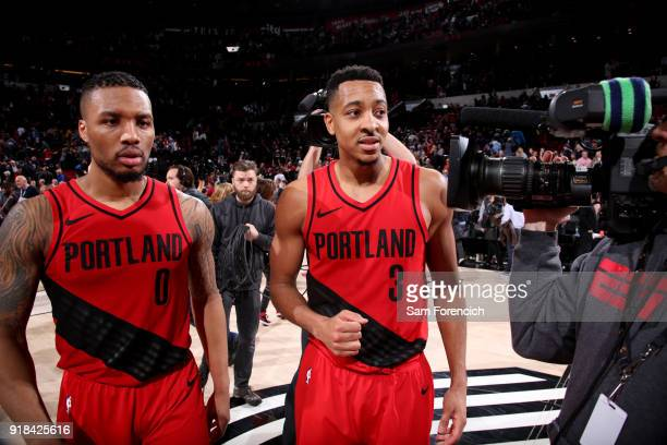 Damian Lillard CJ McCollum of the Portland Trail Blazers talks with the media after the game against the Golden State Warriors on February 14 2018 at...