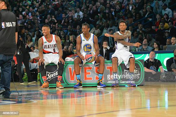 Damian Lillard Harrison Barnes and Ben McLemore of Team West gets ready before the Sprite Slam Dunk Contest on State Farm AllStar Saturday Night as...