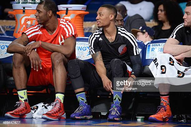 Damian Lillard of Team Hill pulls up his socks during a game against Team Webber during the 2014 BBVA Compass Rising Stars Challenge at Smoothie King...