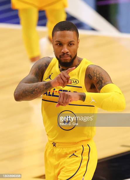 Damian Lillard of Team James celebrates against Team Durant during the second half in the 70th NBA All-Star Game at State Farm Arena on March 07,...