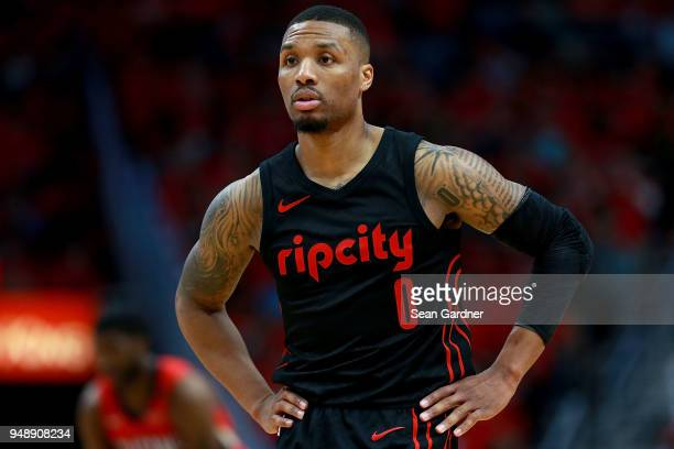Damian Lillard of the Portland Trail Blaers stands on the court as his team trails the New Orleans Pelicans during Game 3 of the Western Conference...